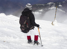 Tourist in a winter mountain Stock Image