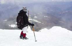 Tourist in a winter mountain Stock Photo