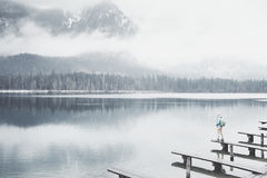 Tourist at winter mountain lake Royalty Free Stock Images
