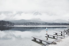 Tourist at winter mountain lake Royalty Free Stock Photography