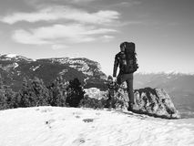 Free Tourist With Big Backpack And Snowshoes Standing On Rocky View Point And Watching Into Rocky Mountains. National Park Alpine Park. Royalty Free Stock Images - 49478109