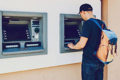 The tourist withdraws money from the ATM for further travel. Finance, credit card, withdrawal of money. Life style Stock Image