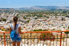 Tourist woman in ancient Archangelos castle in scenic old town on Rhodes island, Dodecanese, Greece. Beautiful picturesque white royalty free stock photo