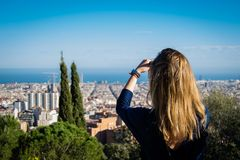 Tourist woman from the back taking photo of Barcelona Stock Photo
