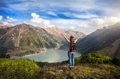 Tourist woman with backpack at the mountains Stock Photos
