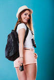 Tourist woman with backpack side view Stock Photography