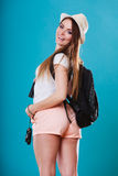 Tourist woman with backpack side view Stock Photos