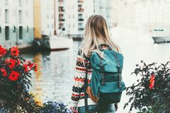 Tourist woman with backpack sightseeing walk in Alesund city. Norway vacations weekend Travel Lifestyle fashion outdoor Stock Images