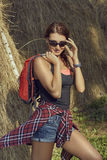 Tourist woman with backpack and sunglasses Royalty Free Stock Image