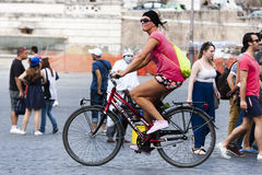 Tourist woman in bike Royalty Free Stock Images