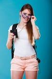 Tourist woman with binoculars on blue Royalty Free Stock Photo