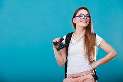 Tourist woman with binoculars on blue Stock Images