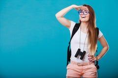 Tourist woman with binoculars on blue Stock Image
