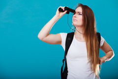 Tourist woman with binoculars on blue Stock Image