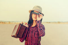 Tourist woman with binoculars Stock Photo