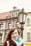Tourist woman with building and old lantern in Main square, Kosi. Tourist woman posing with historic building and old lantern in Main square, Kosice, Slovak Stock Photos