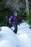 Tourist woman with camera in the snowy forest Royalty Free Stock Photo