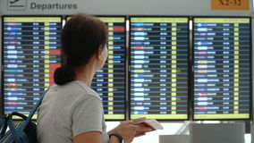 Tourist woman checking timetable at international airport. stock video footage