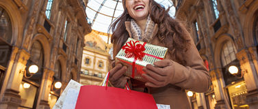 Tourist woman with Christmas gift in Milan looking into distance Royalty Free Stock Photos