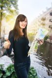 Tourist woman and city map Amsterdam Royalty Free Stock Photos