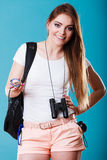Tourist woman with compass in hand on blue Royalty Free Stock Photo
