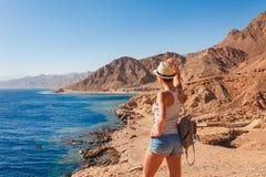 Tourist woman in Dahab near Blue Hole at the Red Sea coast. Famous travel destionation in desert. Sharm el Sheik, Dahab, Sinai. Peninsula, Egypt stock photos
