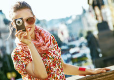Tourist woman with digital camera taking photo in Prague Royalty Free Stock Photo