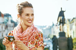 Tourist woman with digital camera on Vaclavske namesti in Prague Royalty Free Stock Images