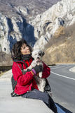 Tourist woman and dog on the road Stock Photos