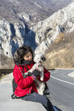 Tourist woman and dog on the road Royalty Free Stock Photo