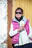 Tourist woman drinking tea and sunbathing in the mountain Stock Photo