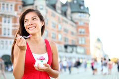 Tourist woman eating ice cream in Quebec City Royalty Free Stock Photography