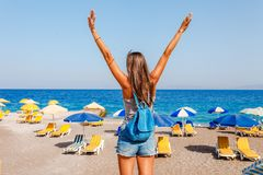 Tourist woman on Elle beach on Rhodes island, Dodecanese, Greece. Panorama with nice sand beach and clear blue water. Famous. Tourist destination in South stock photography