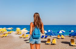 Tourist woman on Elle beach on Rhodes island, Dodecanese, Greece. Panorama with nice sand beach and clear blue water. Famous. Tourist destination in South royalty free stock images