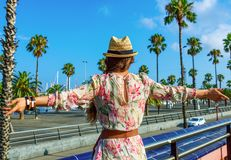 Tourist woman on embankment in Barcelona, Spain rejoicing Stock Photography