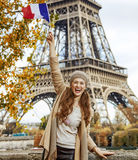Tourist woman on embankment in Paris, France rising flag Royalty Free Stock Images