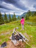 Tourist woman enjoying mountains landscape in Norway. Tourism vacation and travel. Tourist woman in camping site enjoying mountains landscape at summer in Royalty Free Stock Images