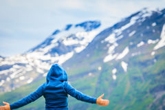 Tourist woman enjoying mountains landscape in Norway. Royalty Free Stock Photo