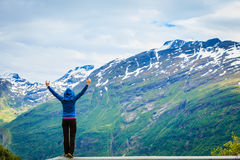 Tourist woman enjoying mountains landscape in Norway. Stock Image
