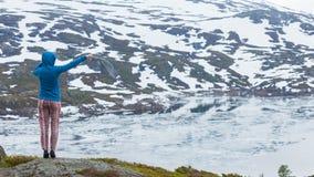 Tourist woman enjoying mountains landscape in Norway Royalty Free Stock Image