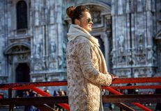 Tourist woman in front of Duomo in Milan looking into distance Stock Photo