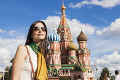 Tourist woman in front of St. Basil cathedral Stock Images