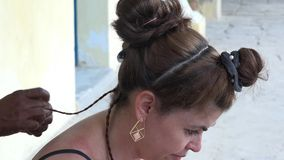 Tourist woman getting afro caribbean hairdo in Old Havana,Cuba stock video