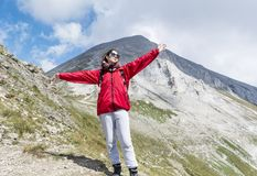 Tourist Woman in a High Mountain. Happy woman in Pirin mountain in the summer stock photos