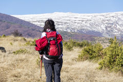 Tourist woman hiking in a high winter mountain Royalty Free Stock Images