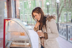Tourist woman holding cup of coffee in the city Stock Images