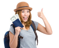 Tourist woman holding passport and money Royalty Free Stock Image