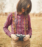 Tourist woman holding vintage photo camera Stock Photos