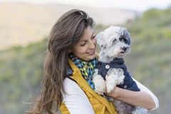 Tourist woman  hugging her white poodle dog outdoor Stock Photo