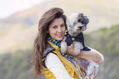 Tourist woman  hugging her white poodle dog outdoor Royalty Free Stock Images